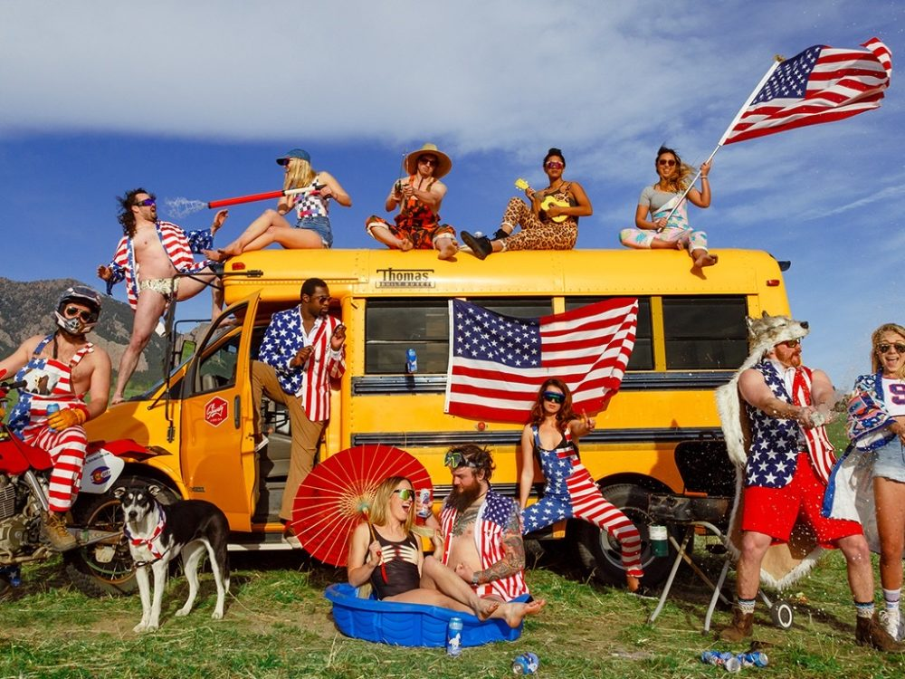Shinesty stock photo of attractive group in American flag apparel around a schooll bus