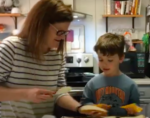 Mother and young son making grilled cheese sandwiches
