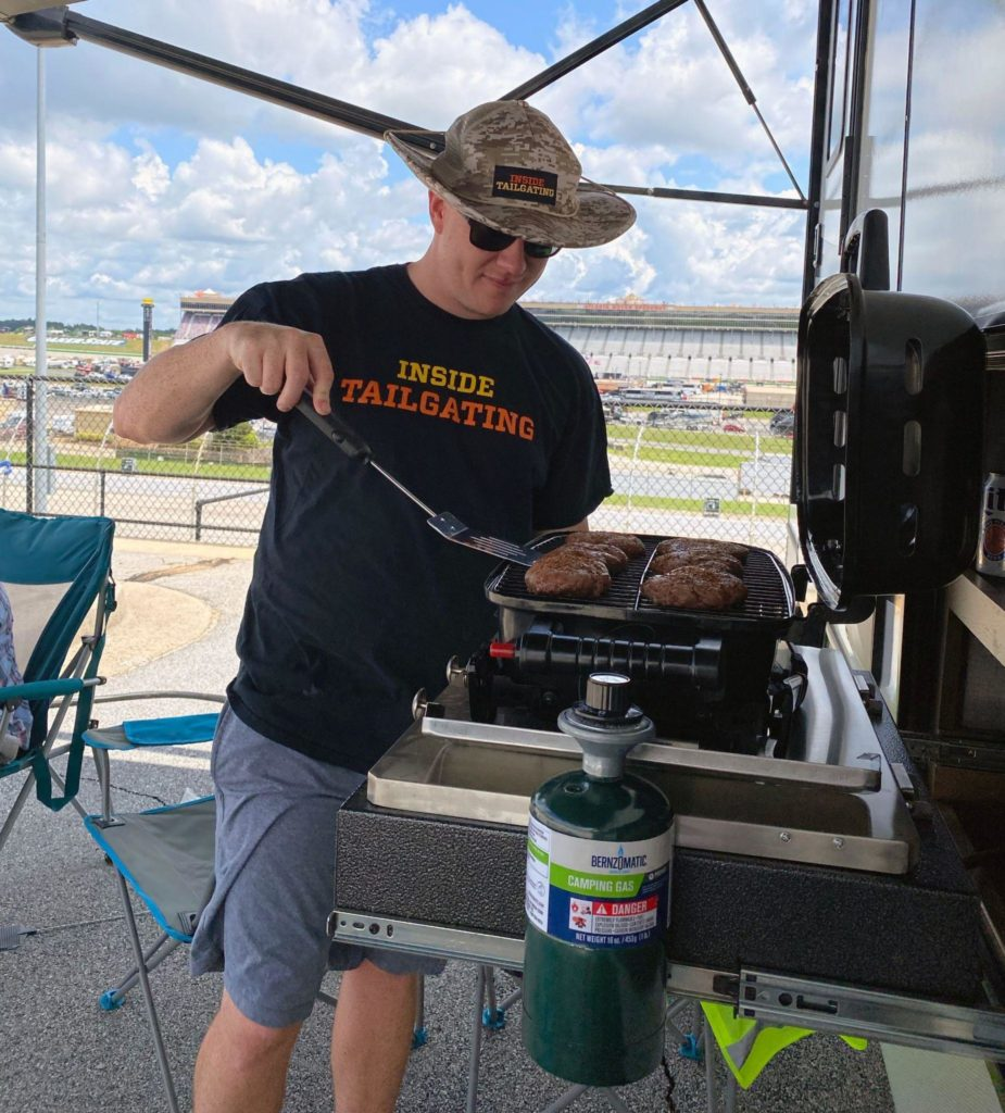 Grilling on a portable grill at Atlanta Motor Speedway Camping Experience